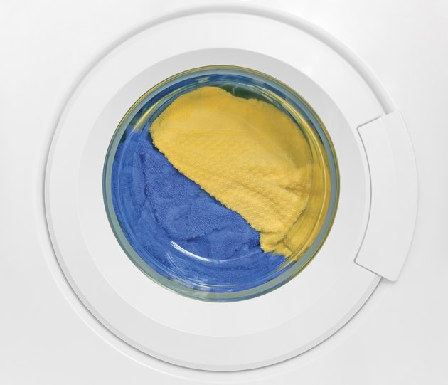 Washing machine door, clean colorful clothes, yellow, blue plush terry