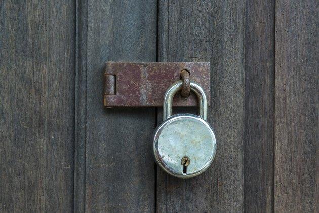 Old padlock on a wooden door