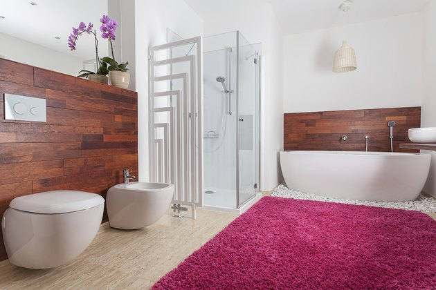 Red carpet in bright bathroom