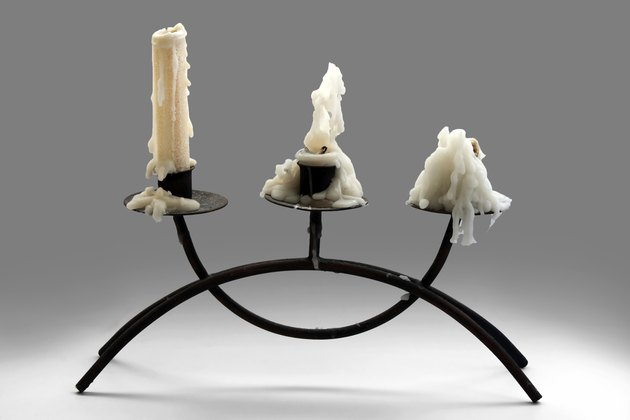 Three white burnt candles