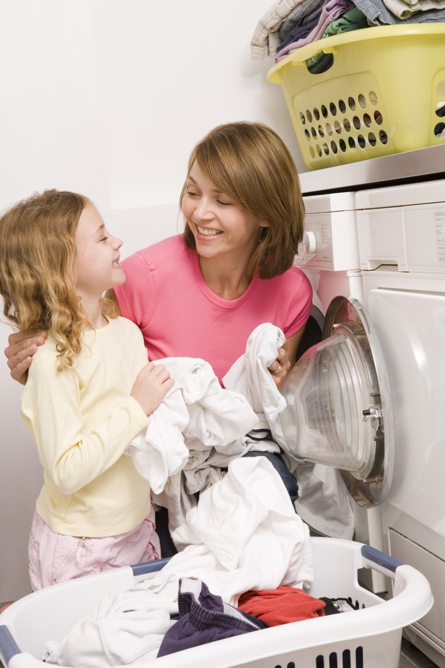 Woman doing laundry with child