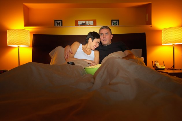 Couple in bed reacting to TV violence