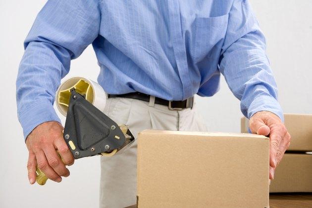 Man taping box