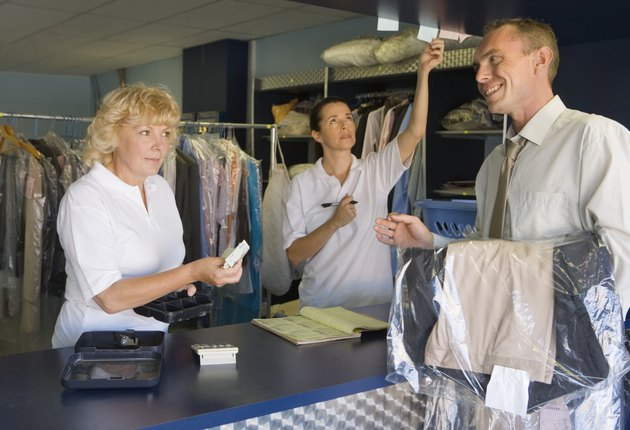 Clerks and customer at dry cleaners