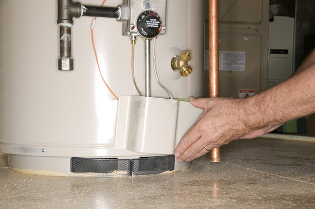 Man checking water heater