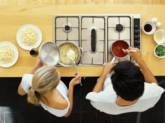 high angle view of a young couple cooking food in the kitchen