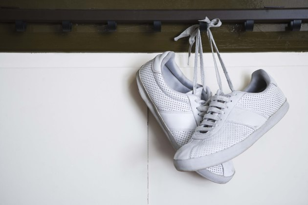 Tennis shoes hanging from locker room peg