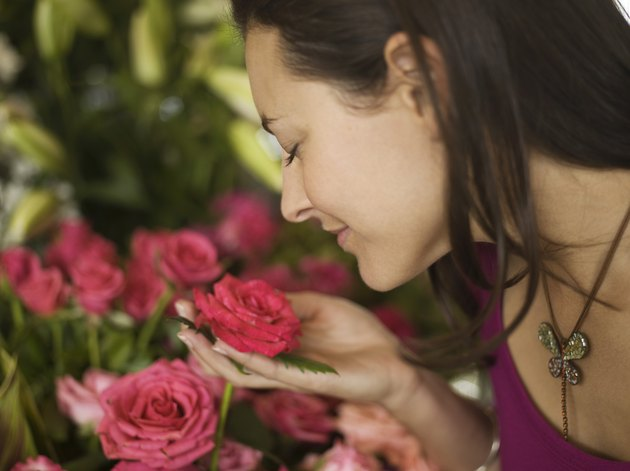 Woman smelling flowers