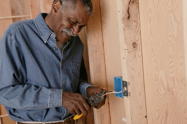 Man installing electrical outlet