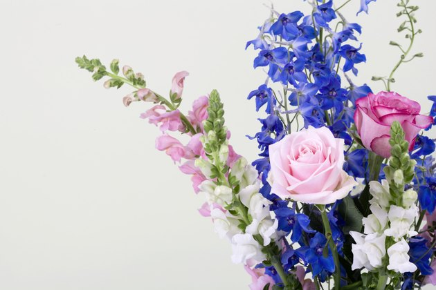 Delphinium, roses, and antirrhinum
