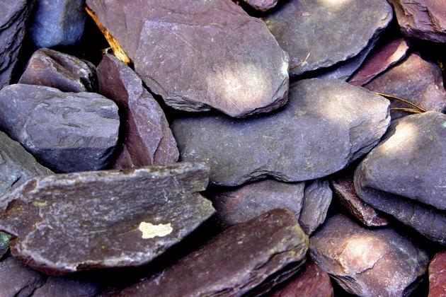 Close-up of purple slate paddle stone in dappled light