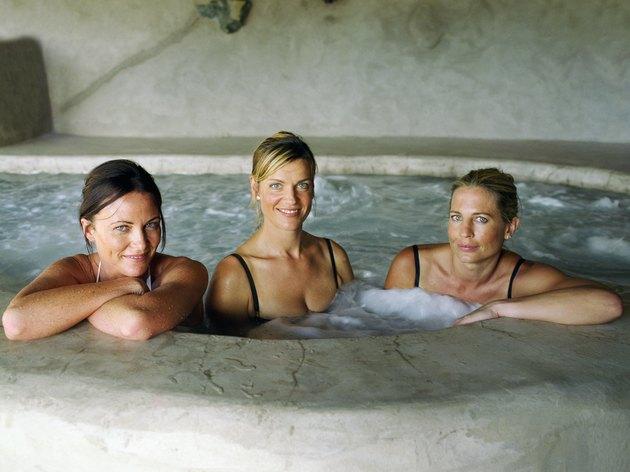 Three women in whirlpool, portrait