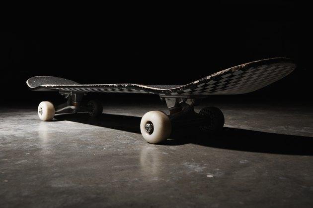 Skateboard on concrete floor