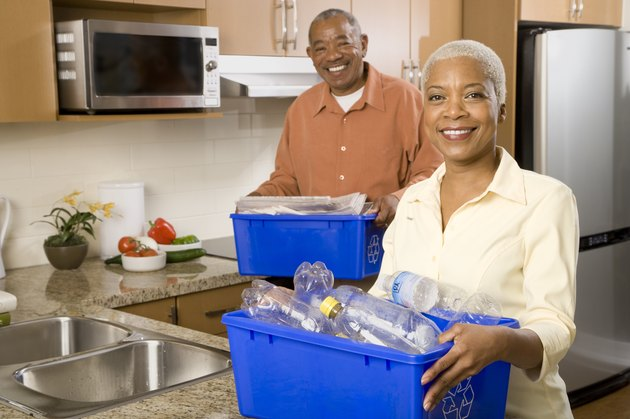 African couple recycling