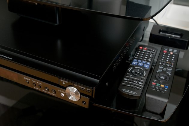 Home entertainment center with remote controls