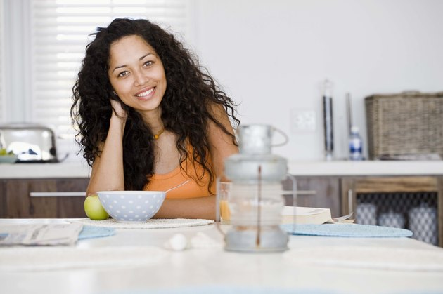 Woman smiling at kitchen table