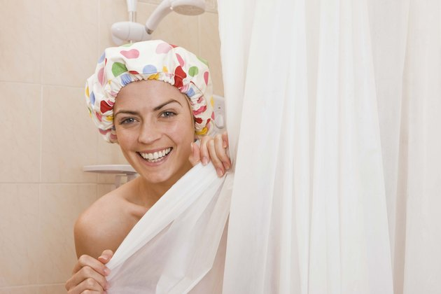 Woman in shower with cap