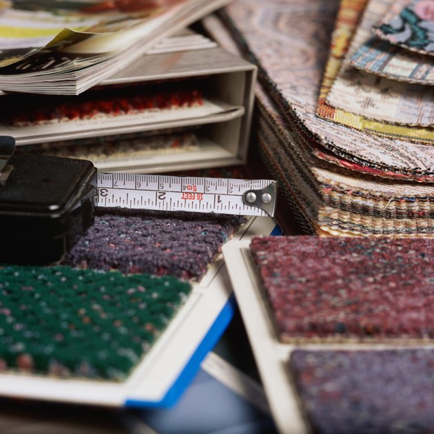 Measuring tape and stacks of carpet samples