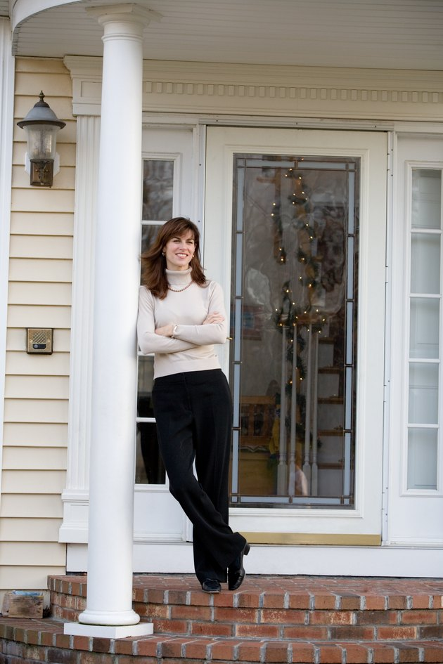 Woman standing on porch