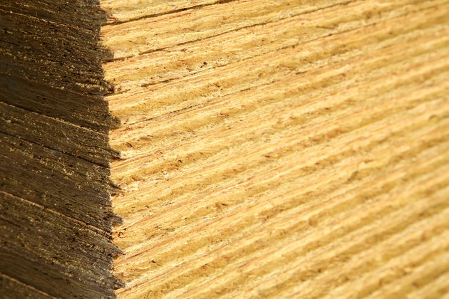 Close-up of stack of sheets of particleboard