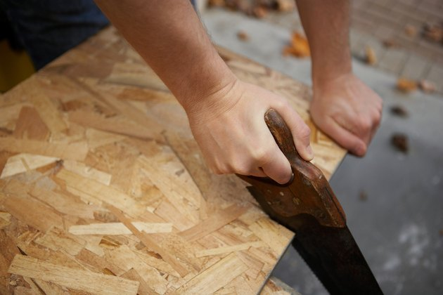 Hands with handsaw