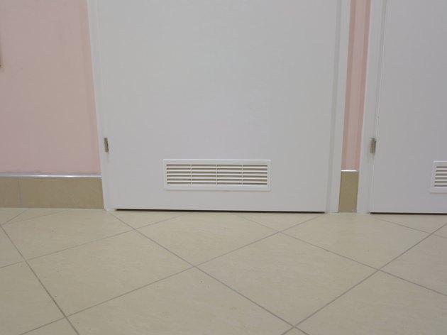 ventilation window on wooden door