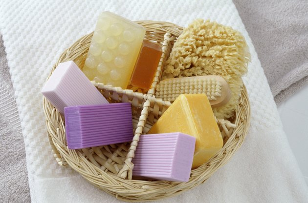 Basket of soaps with a brush and sponge