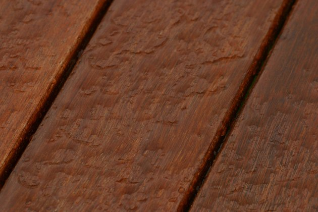 Water on surface of treated wood deck