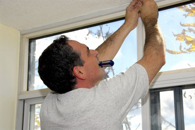 Man installing curtain rod.