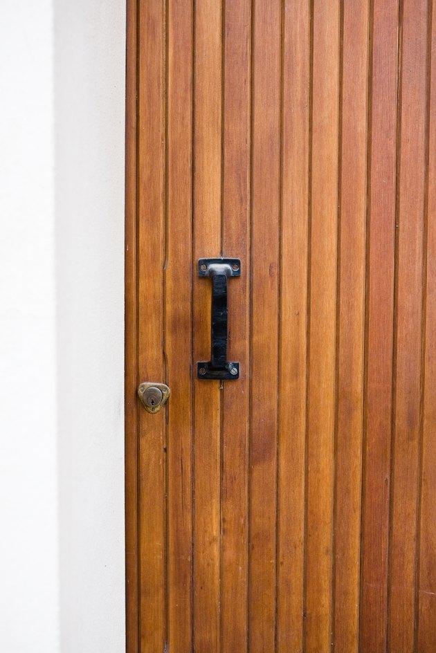 Wood paneling door