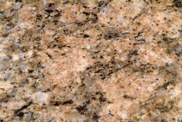 Close-up of surface texture of pink granite rock