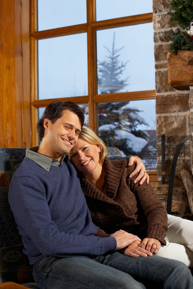 Couple snuggling in rustic chalet