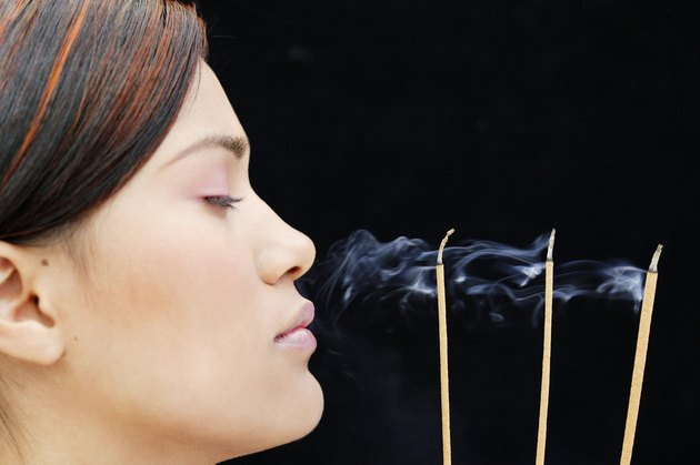 Woman meditating with incense