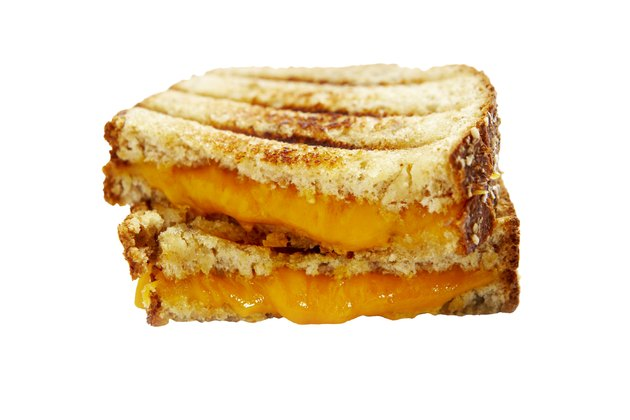 Two halves of grilled cheese sandwich