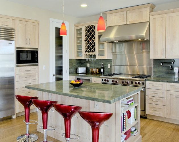 Custom Kitchen with Island and Red Stools