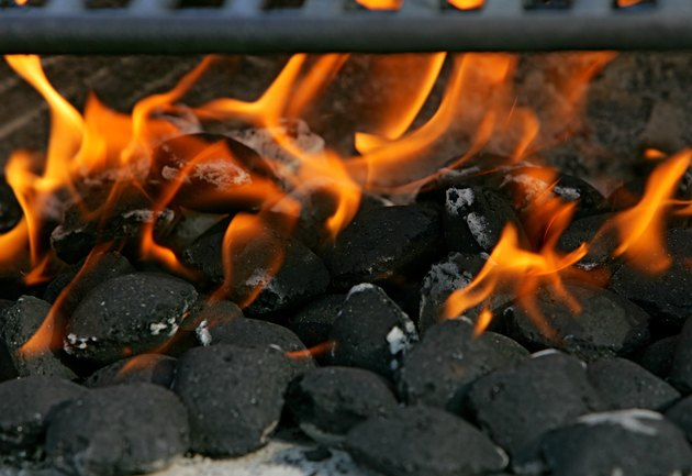 Close-up of Charcoal Briquettes and Flames