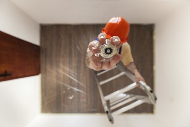 Electrician Is Mounting A Bulb