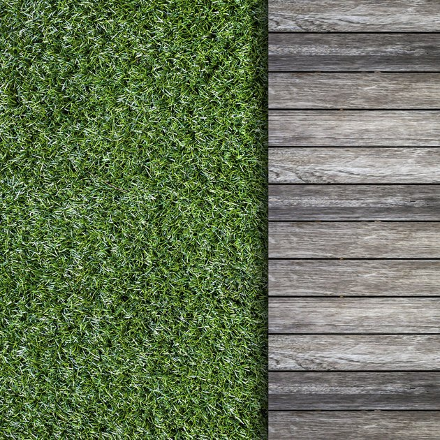 old wooden with green grass background