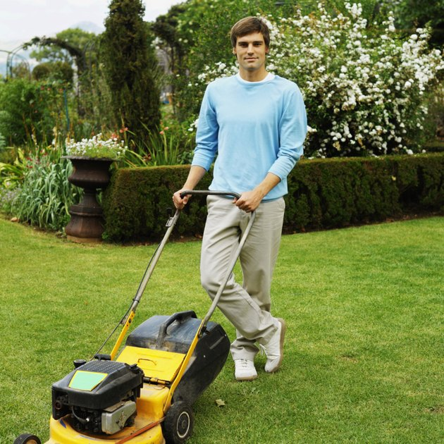 Man mowing the lawn with a lawn mower
