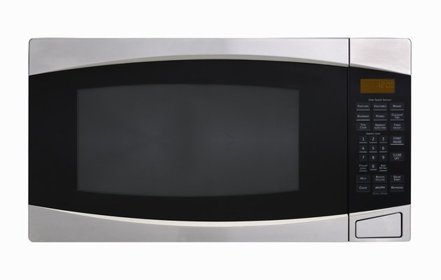 Stainless steel microwave oven on white