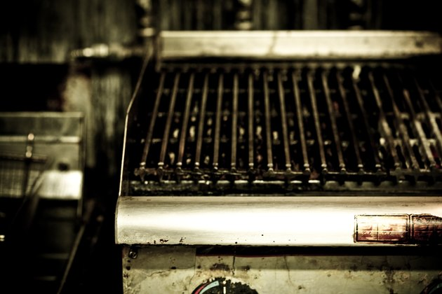 Greasy grill in commercial kitchen