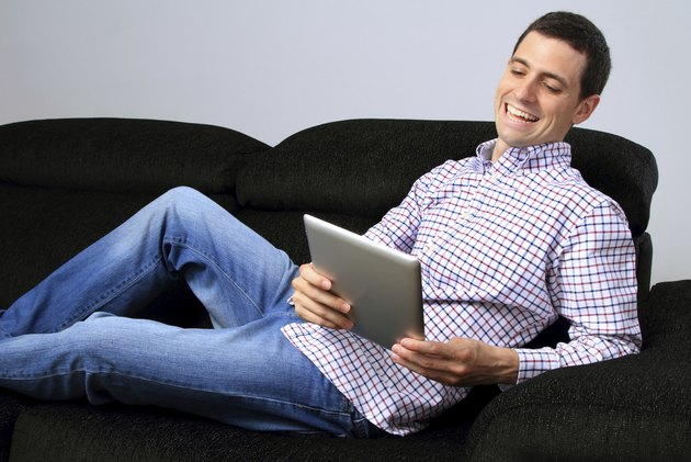 On the couch with tablet