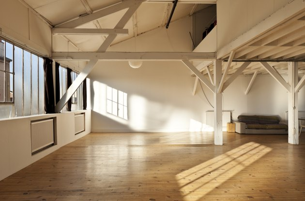large room of loft, beams and wooden floor