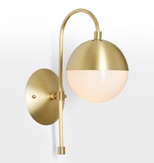 Brass sconce with half-brass half-bare bulb