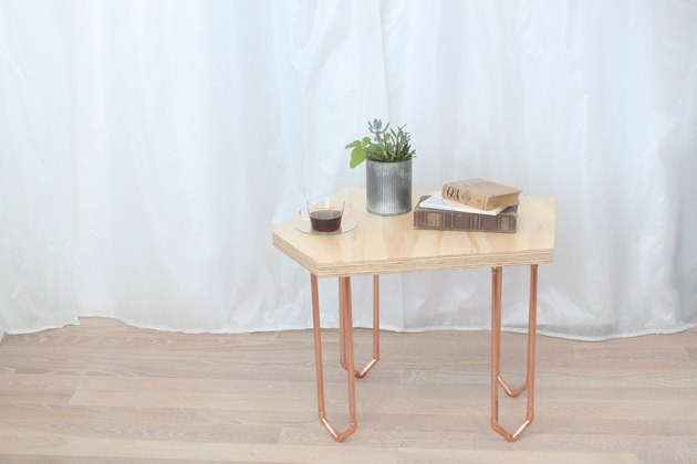 Geometric coffee table with copper legs