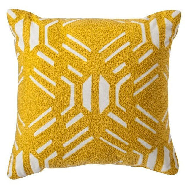 Target yellow and white embroidered pillow.