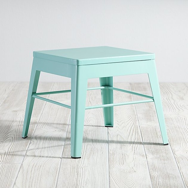 Small mint-colored step stool