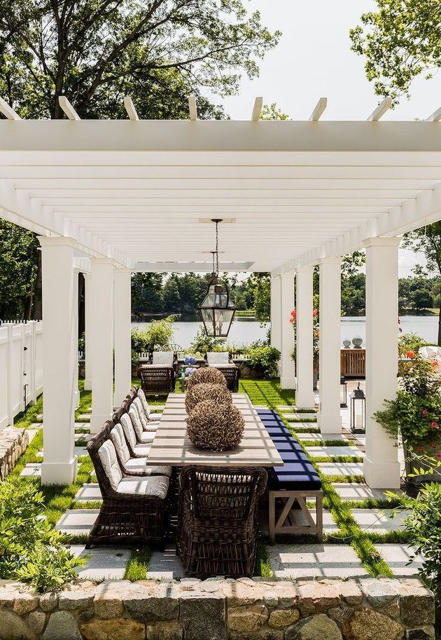 White wide-slatted open roof pergola