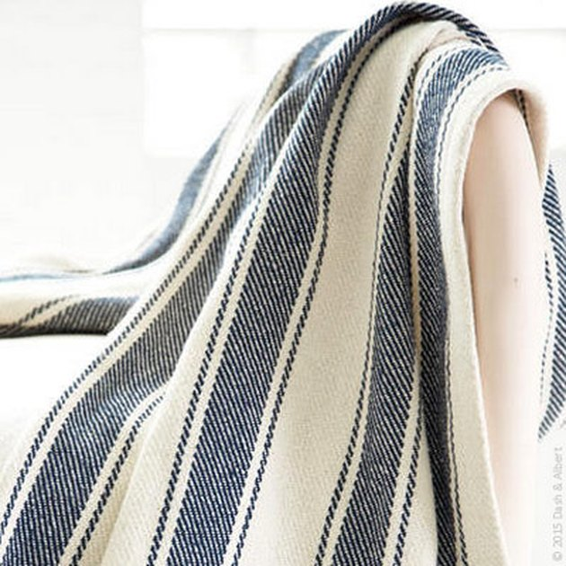 Blue and white striped throw blanket