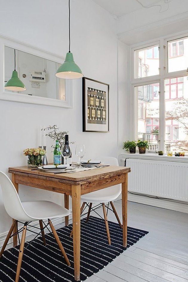 well-placed mirror in small Scandinavian kitchen